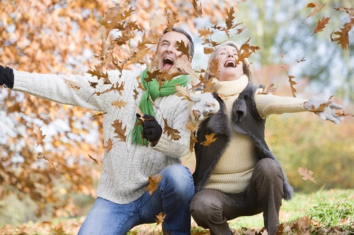 bigstock-Couple-Playing-In-Leaves-Resized