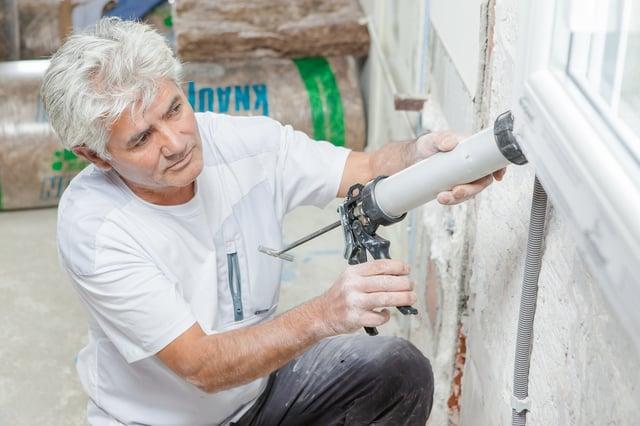 bigstock-Handyman-caulking-a-window-fra-89320295.jpg